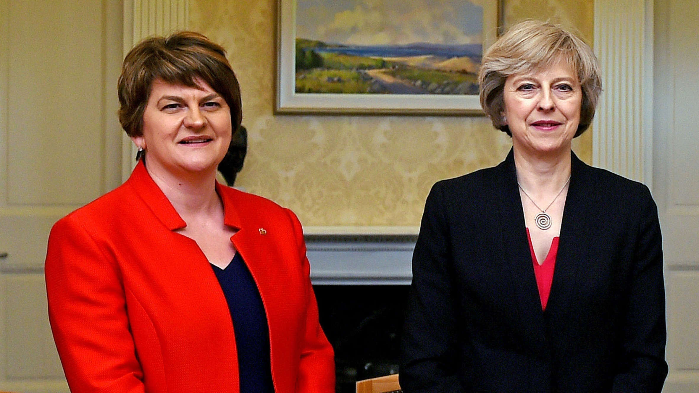 May to talk with NI parties amid concerns over DUP deal