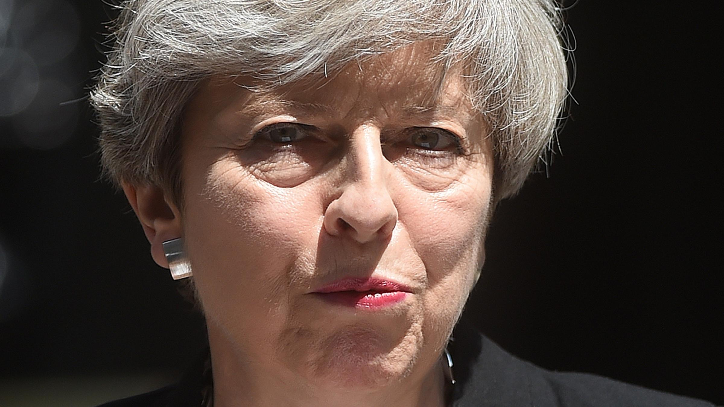 Theresa May 'getting on with job' despite fierce criticism